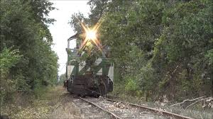 nd w railroad clearing out trees prex 107 switcher on the out of