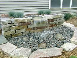 rock diy water fountain idea for small backyard garden