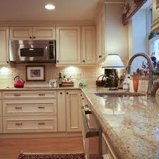 Colonial Cream Granite Design Pictures Remodel Decor And Ideas - Kitchen backsplash ideas with cream cabinets