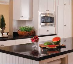 granite countertop white kitchen cabinets with black island