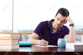 student writing paper writing paper stock photos royalty free writing paper images and writing on paper attractive young man writes a letter by hand