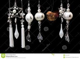 silver and white tree ornaments on black stock