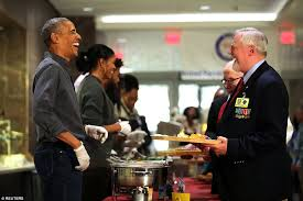 obama helps parents serve thanksgiving meals to veterans in dc