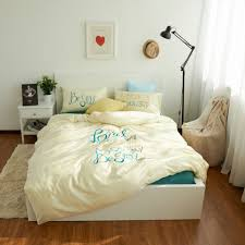 modern bedroom with platform bed and cotton comforter clean a