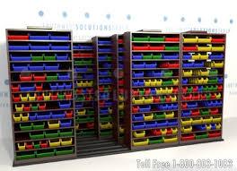 Storage Bin Shelves by Mobile Sliding Bin Shelving Solves Small Parts Storage Problems