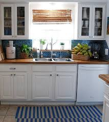 white kitchen cabinets with butcher block countertops butcher block counter tops in blue and white kitchen cabinets ideas