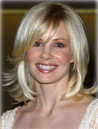 medium long flipped hair blonde mid length shag flipped hair with bangs medium hairstyles