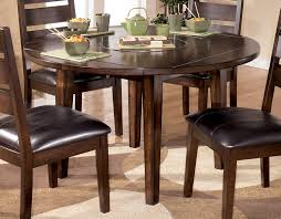 square to round dining table larchmont round dropleaf dining table by signature design tenpenny