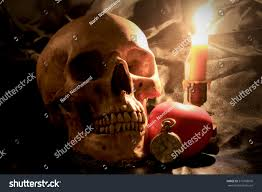 halloween skull with candle background human skull vintage pocket clock red stock photo 573768676