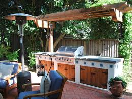 world style outdoor kitchen outdoor kitchen ideas a wooden pergola shades this southwestern style outdoor kitchen