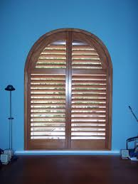 arch top shutters or arched window shutters on side windows in london