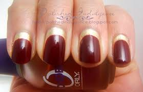 polished indulgence nail art wednesday red and gold ruffian nails