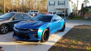 black camaro with black rims z 28 rims on a hyper blue 2016 camaro ss