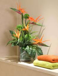 birds of paradise and alliums in a glass cube rtfact