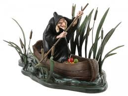 walt disney classic witch in boat figurines and ornaments