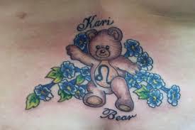 teddy bear tattoo with blue flowers tattoos book 65 000