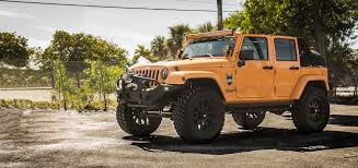 jeep wrangler orange offroad 4x4 jeep wrangler jeep monster sahara big rims wheels