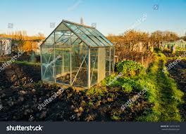 allotment vegetable gardens glass greenhouse plot stock photo
