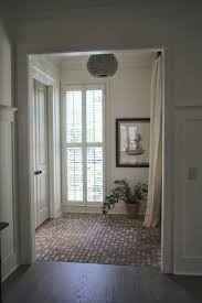 great and welcoming greige palette entry way with brick floor