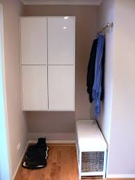 Ikea Entryway Storage A White Hallway With Shoe Cabinets On The Wall Combined Hat