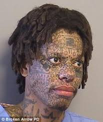 black man with swastika tattoo on forehead arrested for causing