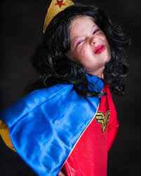 funny faces from lilly in her wonderwoman halloween costume