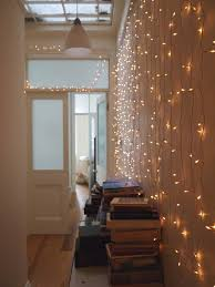 lights on wall with pictures 45 inspiring ways to decorate your home with string lights