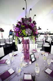 round table centerpiece ideas wedding table decor ideas with tall purple flowers on glass 50th