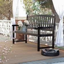 exterior white wooden porch bench with brown seat using blue