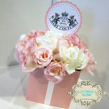 Centerpieces For Baby Showers by Pink Dress With Pink Shoes Combined With White Pink Flowers On The