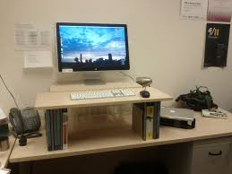 Used Sit Stand Desk by Furniture Simple Monitor Stand Ergonomic Desk With Used Snack Can