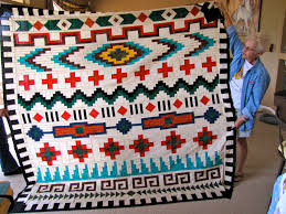looks like a beautiful seminole type pieced quilt with navajo