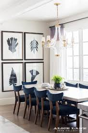navy blue velvet dining chairs with large crystal cube chandelier