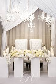 wedding flowers table pristine white table orchid wedding flowers wedding decor
