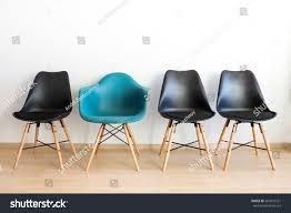 blue comfortable chair among black stock photo 564019321
