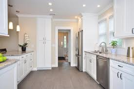 awesome tall white cabinets with kitchenaid stainless steel