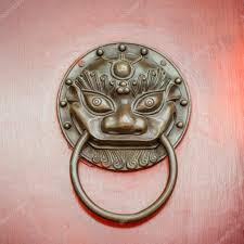 foo dog door knocker foo dog or lion door knocker on beijing door stock photo
