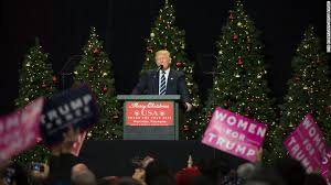 trump fist raised wishes all a merry christmas cnnpolitics