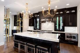 black kitchen cabinets with marble countertops gold and black kitchen with thick white marble countertops