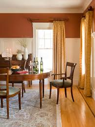 Pale Yellow Curtains by This Traditional Style Dining Room Features White Wainscoting