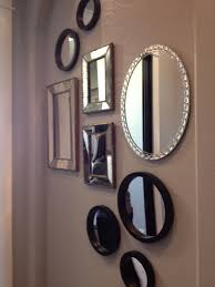wall of mirrors in hallway making this house our home