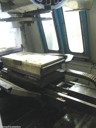 akira seiki apc 600 cnc vertical machining center machinestation