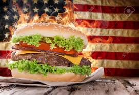 Flag On Fire Delicious Hamburger With Fire Flames And American Flag On Wooden