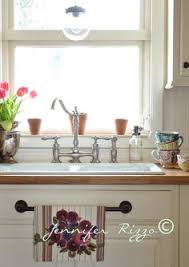 kitchen towel holder ideas use a towel hanger on that false drawer for your dish towels in
