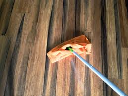 simple handmade cleaning bamboo floor from napkin and blue stick
