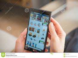 amazon smartphones black friday young women shopping through mobile on amazon on black friday