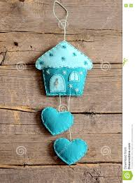 felt house with hearts decor on old wooden background handmade