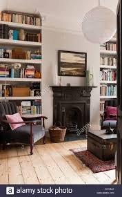 white painted bookshelves in sitting room with traditional