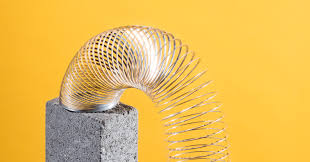 the history of the slinky wired
