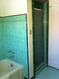 painting vintage green tiled bathroom